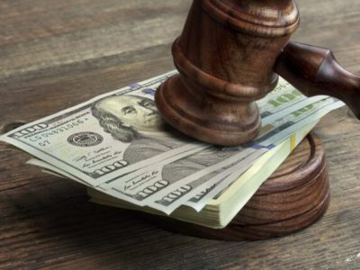 Close-up Of Judges Gavel, Soundboard And Bundle Of Dollar Cash On The Rough Wooden Table. Concept For Corruption, Bankruptcy Court, Bail, Business Or Financial Crime, Bribing, Fraud, Auction Bidding